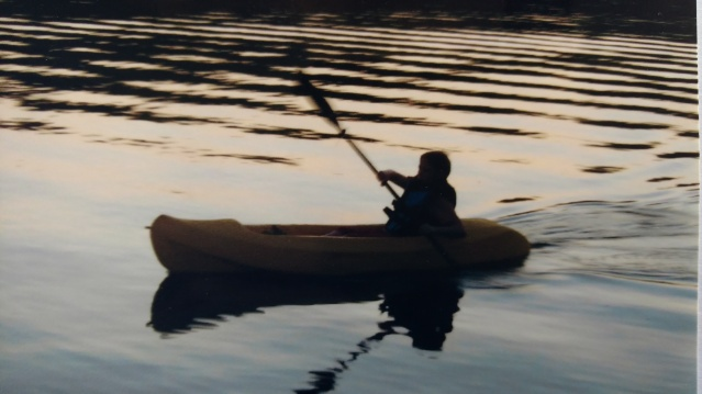 Silhouette of author's child when young, learning to kayak.