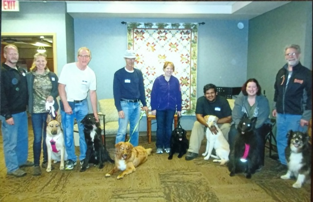 Group photo of recent therapy dog team graduates.