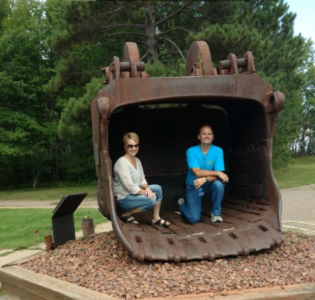 Author's friend couple inside an old mining scoop bucket.