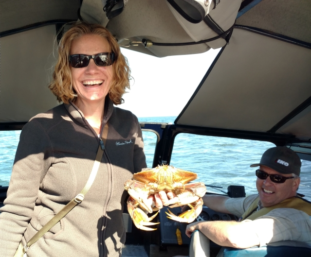The author and her brother crab fishing on his boat.