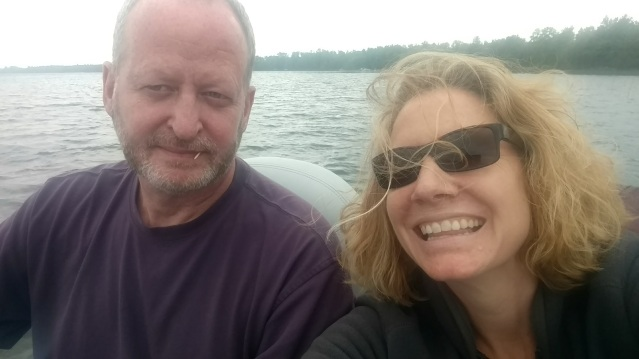 Selfie of author and husband on the lake.