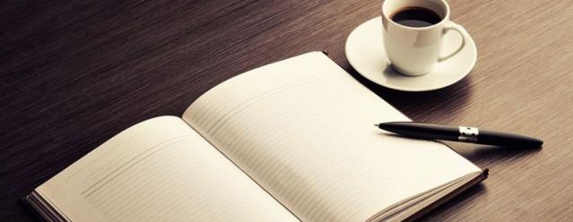 open journal, beautiful pen, cup of coffee