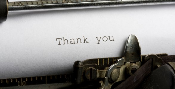 paper in a typewriter that says thank you