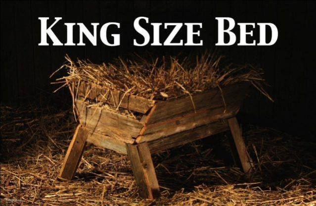 Image of an empty, readied manger with the words King Size Bed across the top.