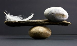 feather-rock-balance