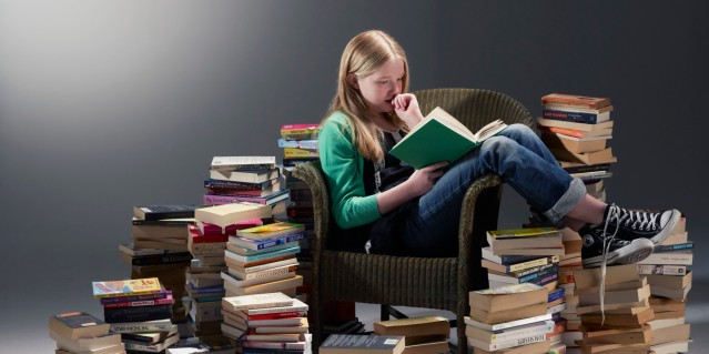 reading girl surrounded by books