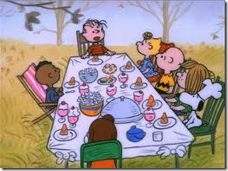 The Peanuts gang sitting at a dinner table.