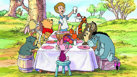 Winne-the-pooh gang all seated at a table.